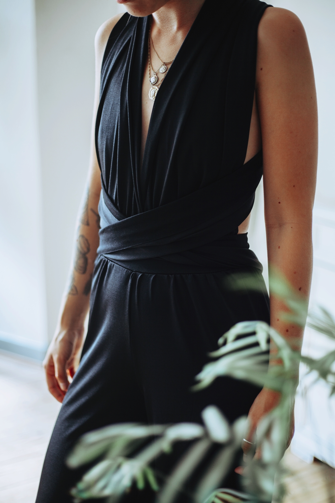 Dressed up for party in a black slinky multiway jumpsuit from femme luxe finery.