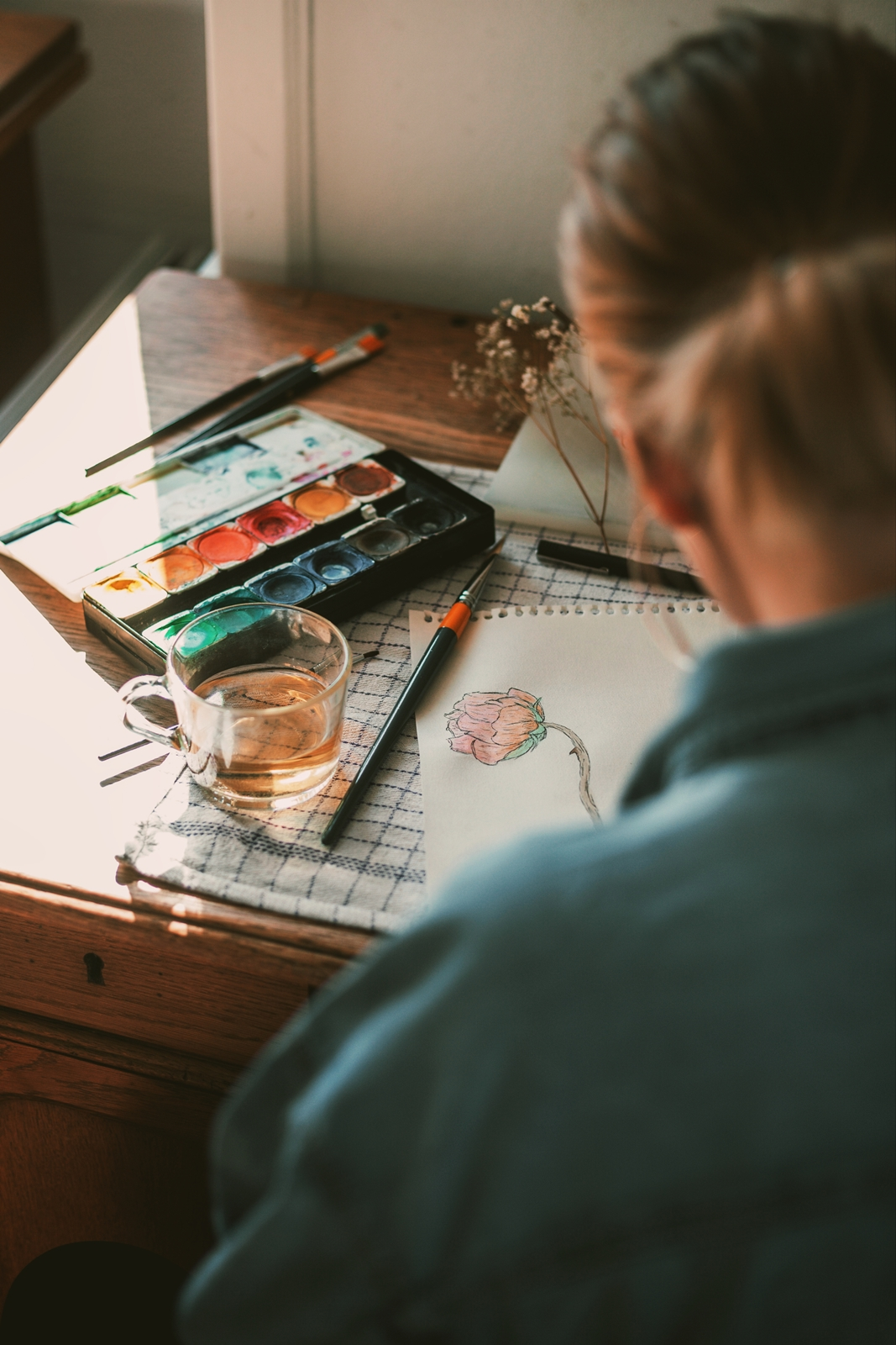 watercolor palette, glass of cider, me painting