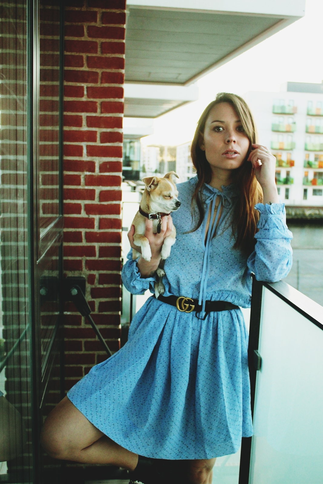 posing with dog in blue dress and combat boots
