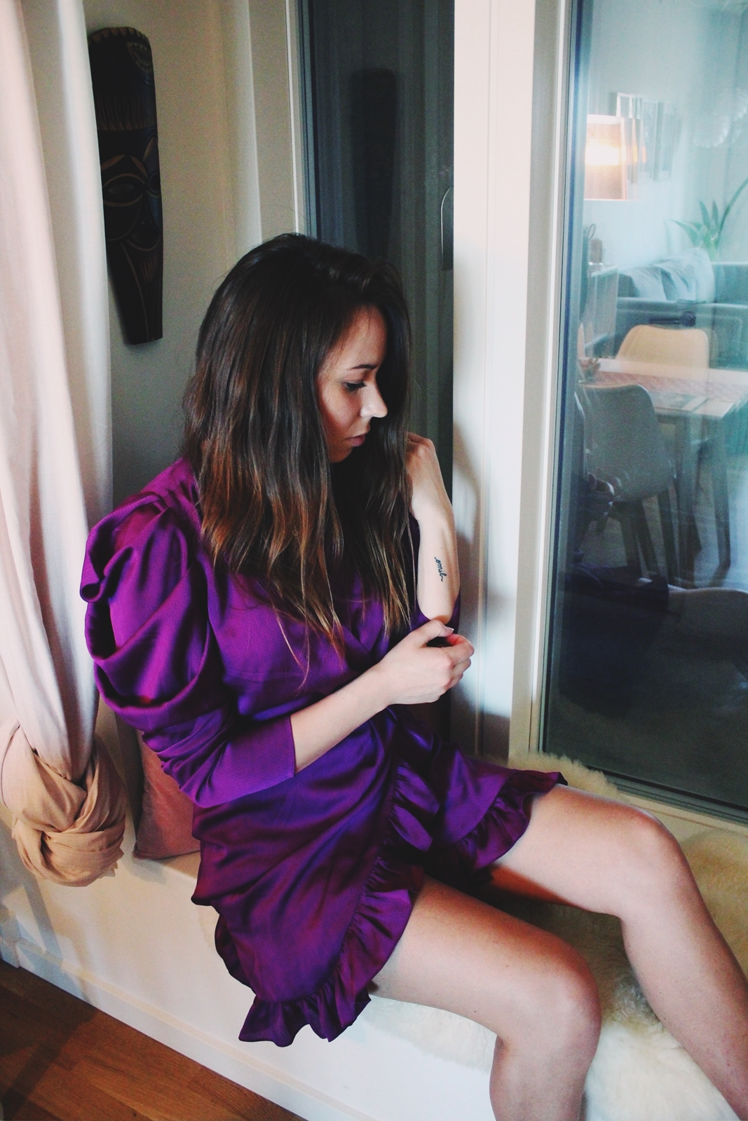 sitting by the window and posing in my new purple dress