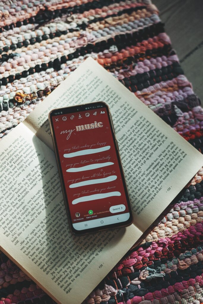 my phone on a book showing an instagram template i made