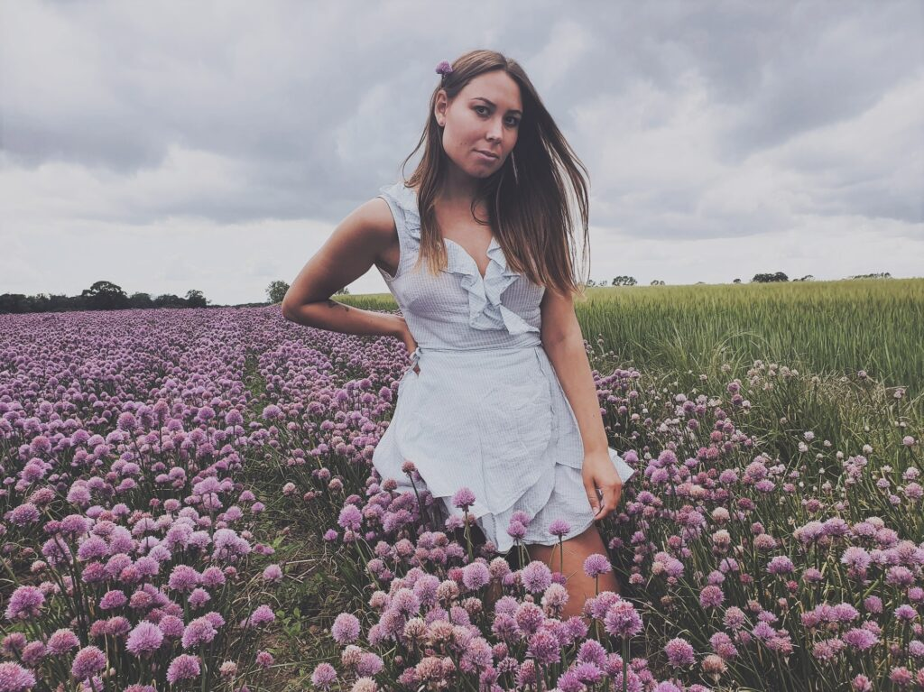 posing in a flower field